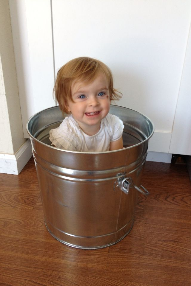 Baby photo bucket super cute maybe out in a field.