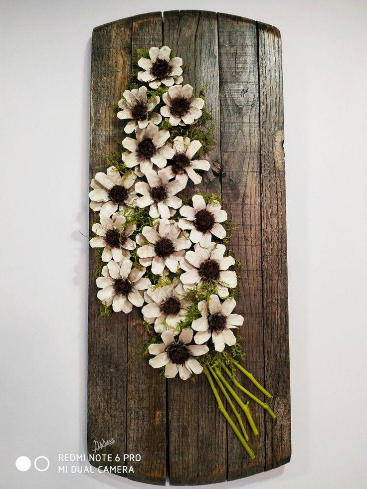 Bouquet von Tannenzapfen Gänseblümchen