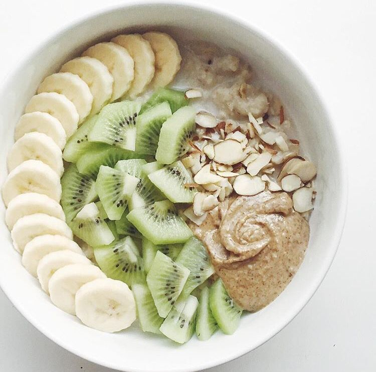 {oats soaked overnight in almond milk + maca + ground flax + chia seeds & topped w/ banana + kiwi + sliced almonds + almond butter}