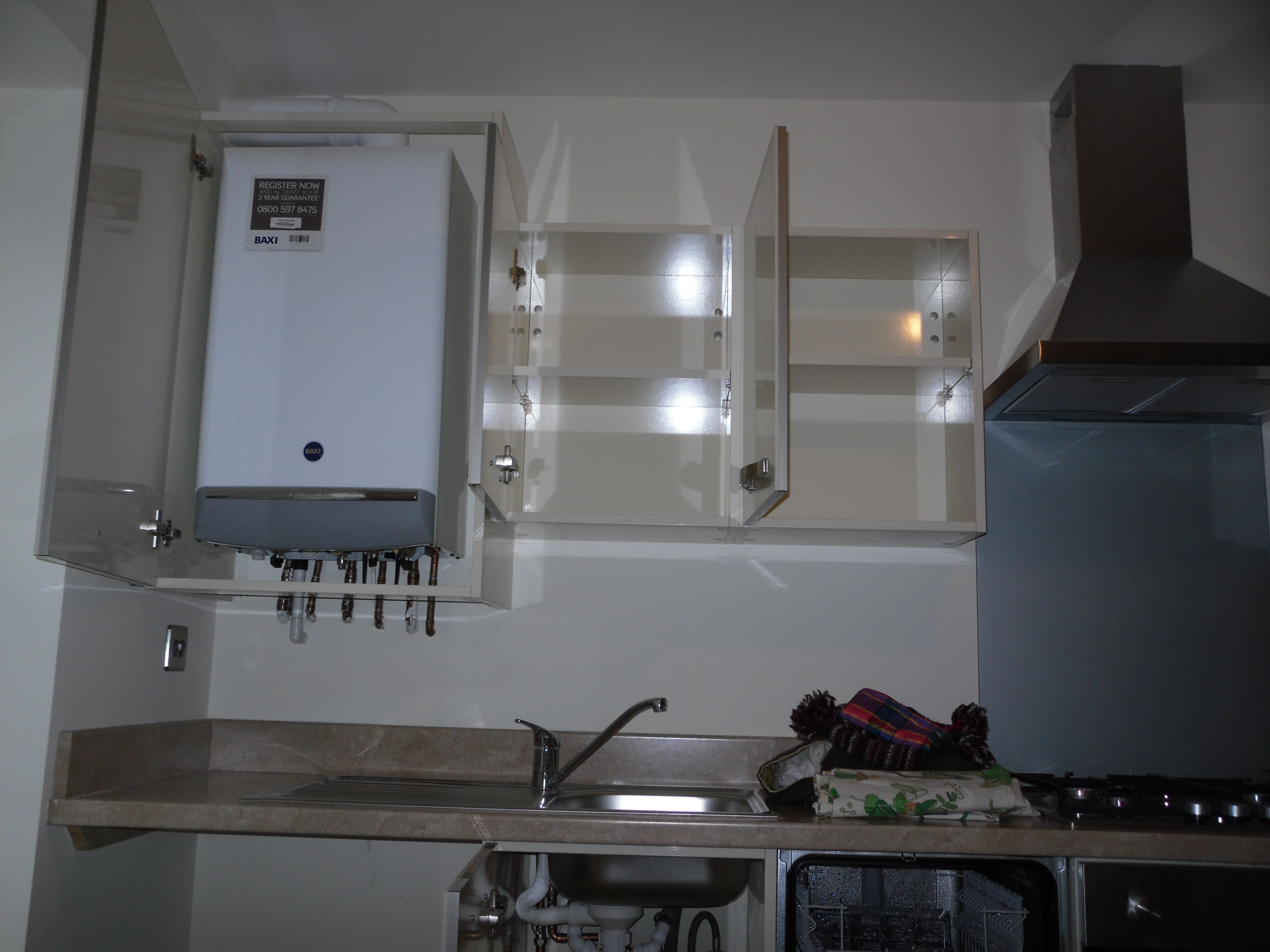 Inside boiler sink dishwasher cupboards baxi combi for Kitchen unit for boiler