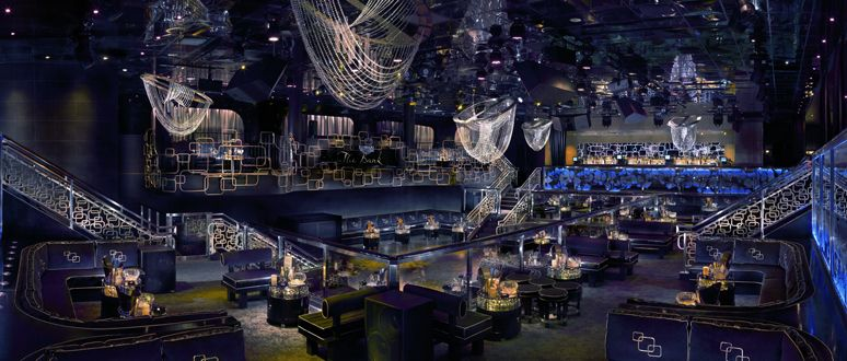 The Bank Nightclub at the Bellagio, where the guests enter through a grandiose foyer adorned with bottles of Cristal stacked floor-to-ceiling on each ...