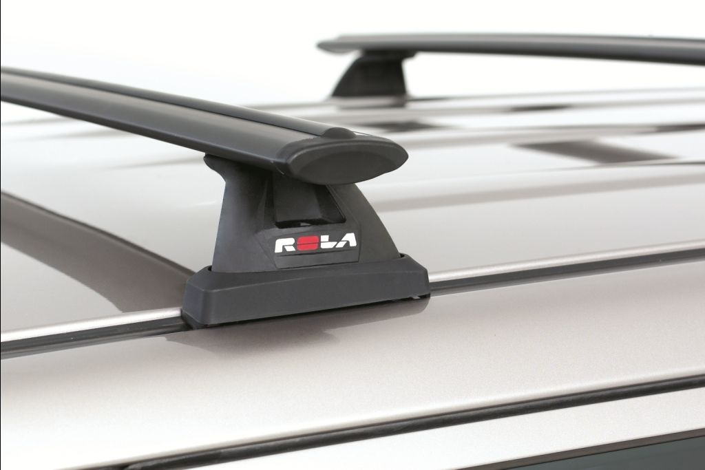 A Roof Rack Is Usually Mounted Onto A Set Of Bars That Run Across The Roof Of A Vehicle Most Cars However Have No Such B Car Roof Racks Roof Racks