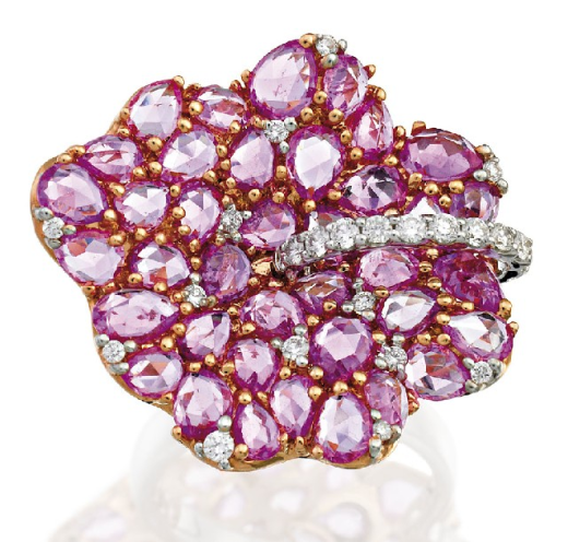 SAPPHIRE AND DIAMOND RING   Modelled as a flowerhead set with rose cut pink sapphires highlighted with round brilliant cut diamonds, the sapphires and diamonds together weighing approximately 7.50 carats and 0.40 carats respectively, mounted in 18ct white gold,