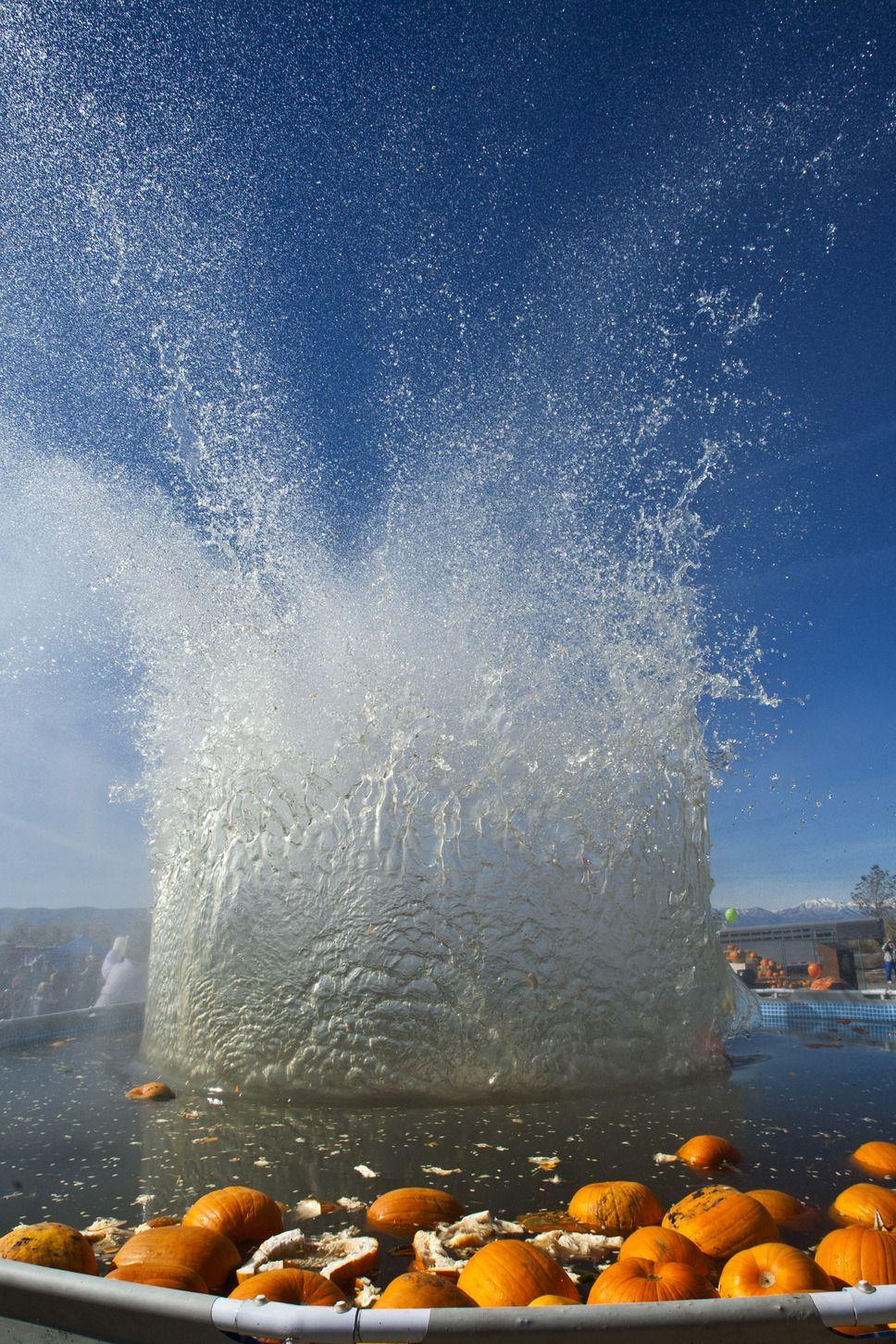 A 450 Pound Pumpkin Is Dropped Into A Swimming Pool From A Height Of 150 Feet During Utah S 4th Annual Ginormous Pumpkin Drop At Hee Lake Utah Pleasant Grove