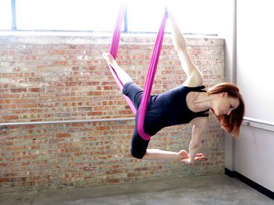 pinkatie gromlovits on acrobatic fabric  aerial yoga