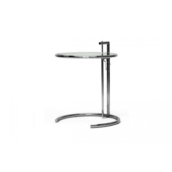 Scientific precision defines the Eileen Gray table, inspired by the E1027. The circular, beveled glass tabletop is surrounded by sleek metal tubing, and mirrored by a horseshoe of the same material which keeps the table planted firmly on the ground.Designed for her sister her loved to breakfast in bed...the table has an adjustable height!