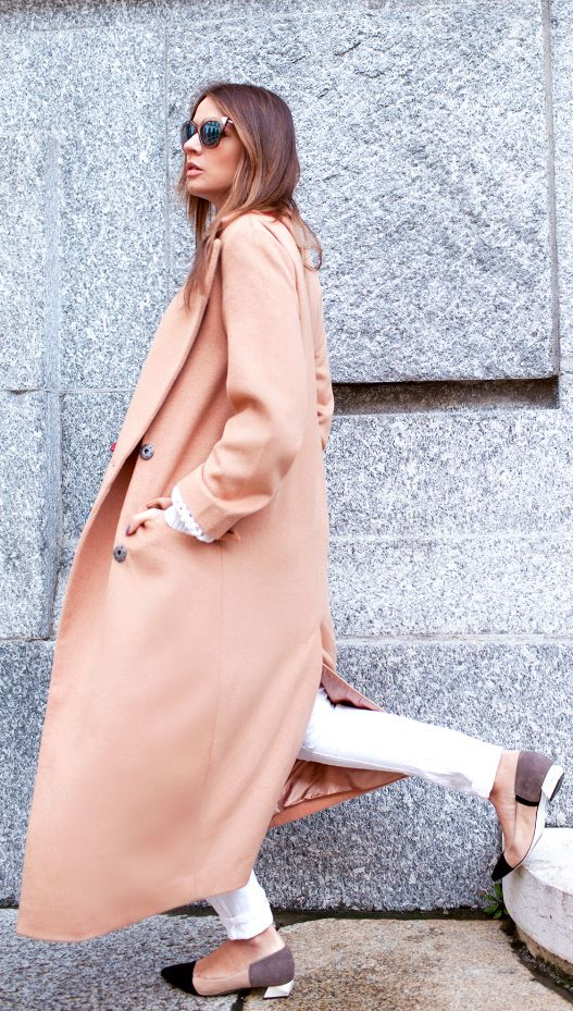 Veronica Ferraro is wearing a long camel coat from Asos