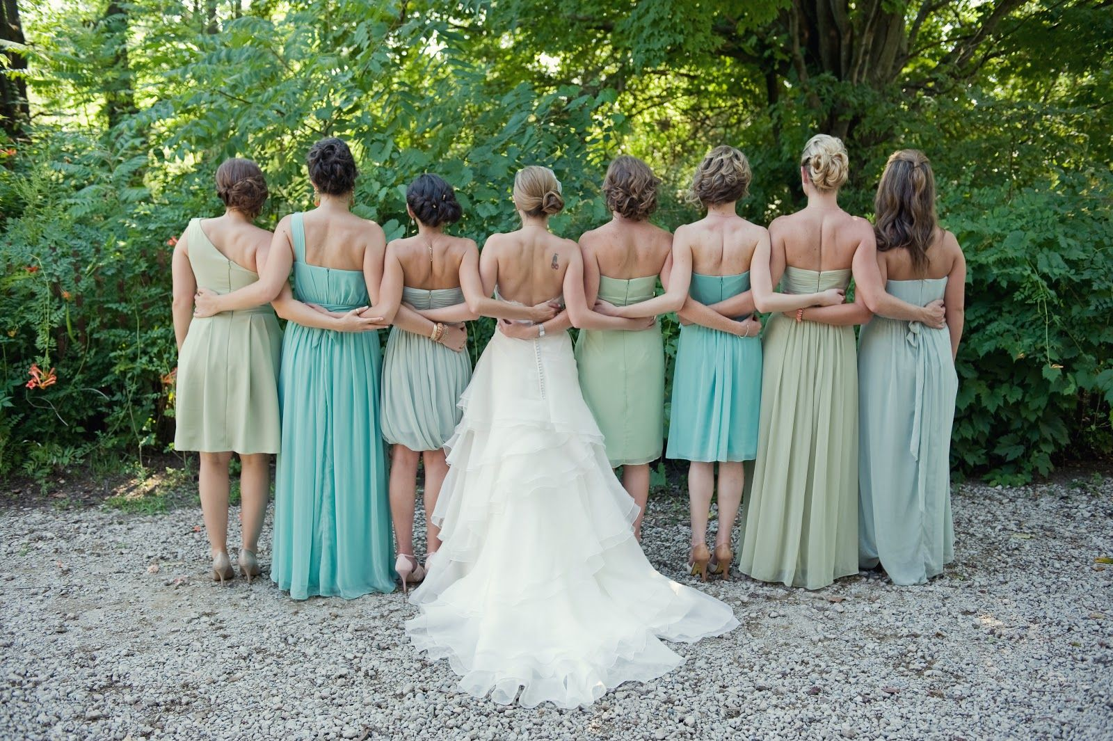 Bridesmaids pic arms intertwined mismatched green dresses bridesmaids pic arms intertwined mismatched green dresses ombrellifo Choice Image