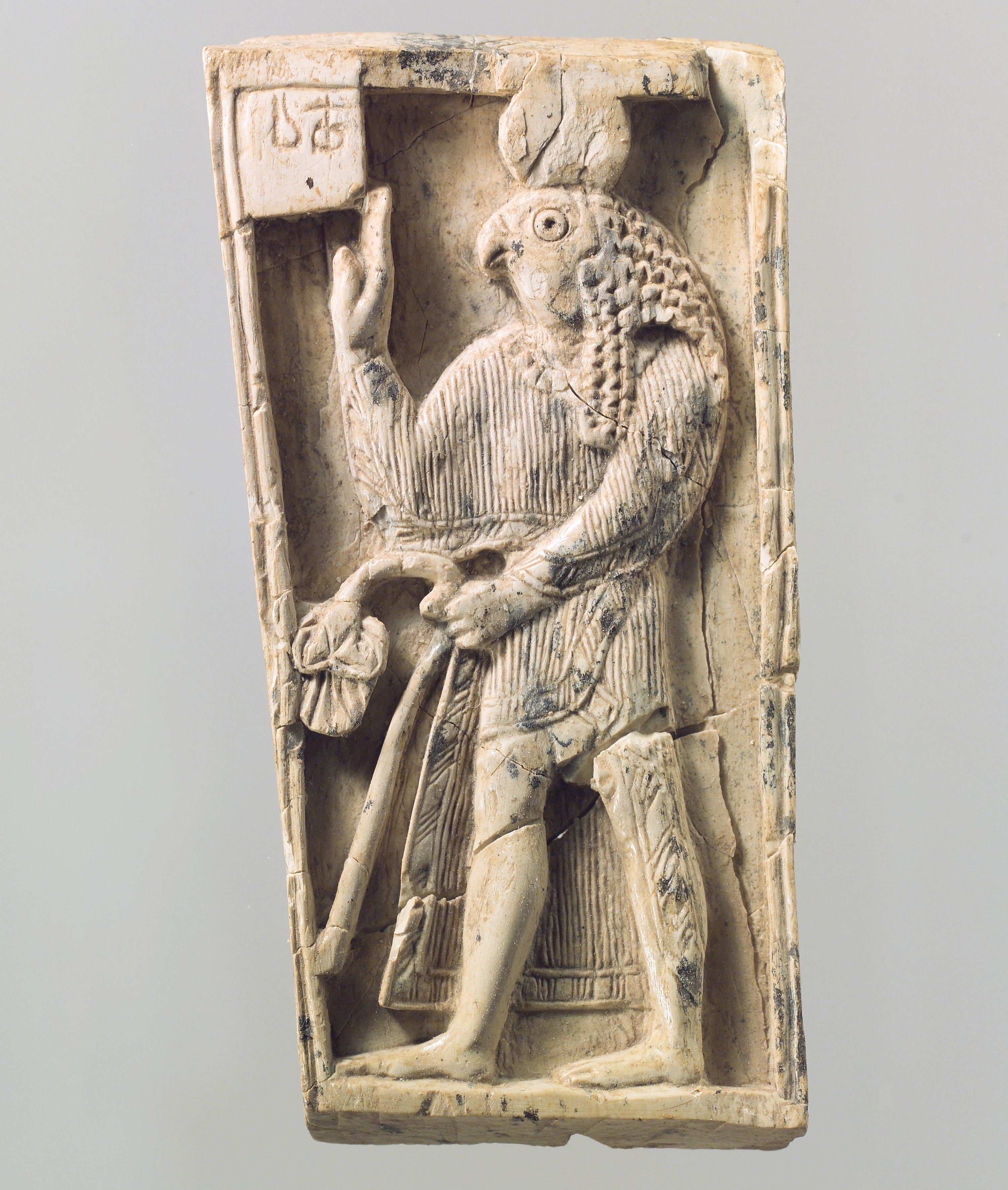 Plaque with a falcon headed figure ca 9thu20138th