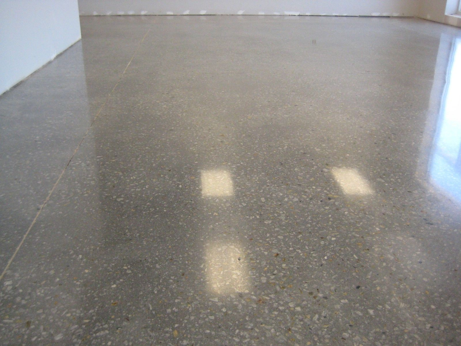 Finished concrete floor is polished concrete flooring for Concrete floors in house