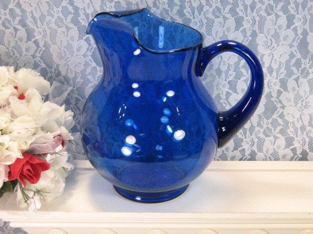 Vintage Cobalt Blue Glass Water, Lemonade or Ice Tea Pitcher, 64 Ounce, Mid Century Glass, Vintage Kitchen Glass or Barware by havetohaveit on Etsy https://www.etsy.com/listing/122821606/vintage-cobalt-blue-glass-water-lemonade