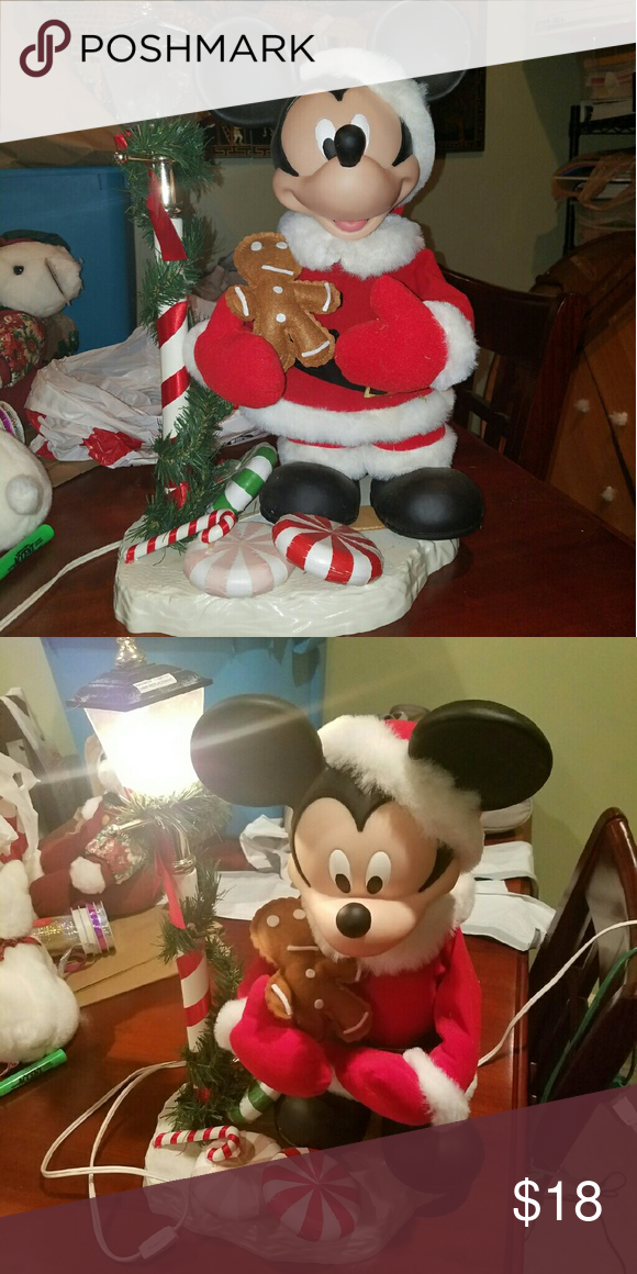 Moving Mickey Mouse Christmas decor A little over a foot and a half high, adorable Mickey Mouse Christmas decoration lights up and moves. In perfect condition and a must have for any Disney lover! Disney Other