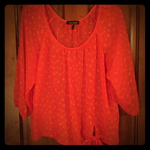 Orange sheer polka dot blouse Love this orange polka dot blouse. Has the side tie on the bottom so it can be loose or tight to what ever you like. I only wore a couple times and wore a camisole tank underneath it. It could also be as a bathing suit cover up. The sleeves are 3/4 in length. HeartSoul Tops Blouses