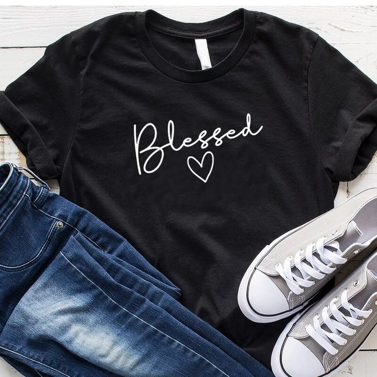 Blessed T-Shirt | Wear this t-shirt with pride knowing that a % of your purchase goes towards spreading the word of God. Part will go to building new churches, and part will go to sending missionaries around the world. Our Blessed T-Shirt is not only adorable but extremely soft too! Its bold Message will be sure to turn heads!  #tshirt #womenstshirt #womensfashion #christianapparel #tshirtforwomen #Love #God #Clothes #Christ #valerymilano