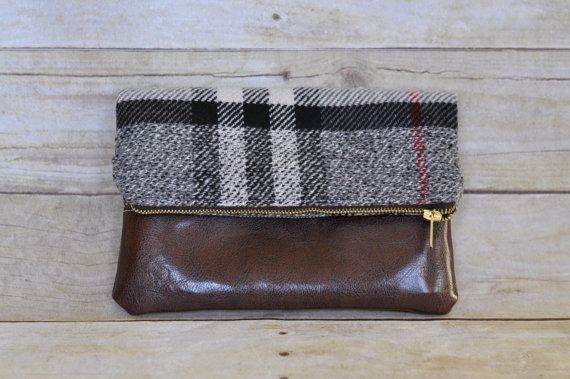 Wool plaid and faux leather fold over clutch This plaid and faux leather clutch is perfect for a night on the town with the girls or date night