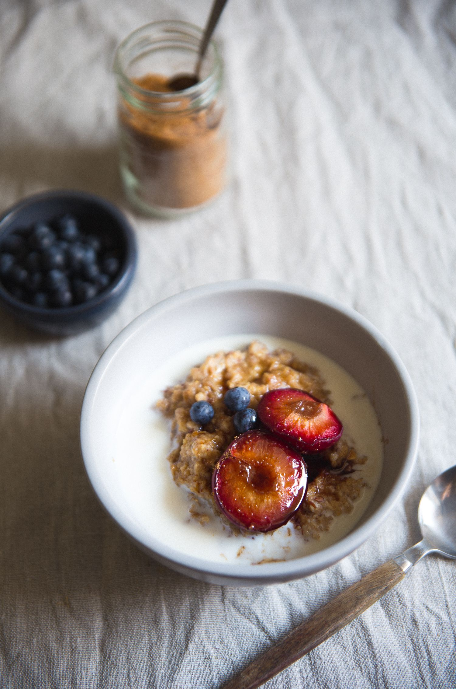 Multigrain Porridge with Balsamic Caramellized Plums & Goat Milk | Cashew Kitchen