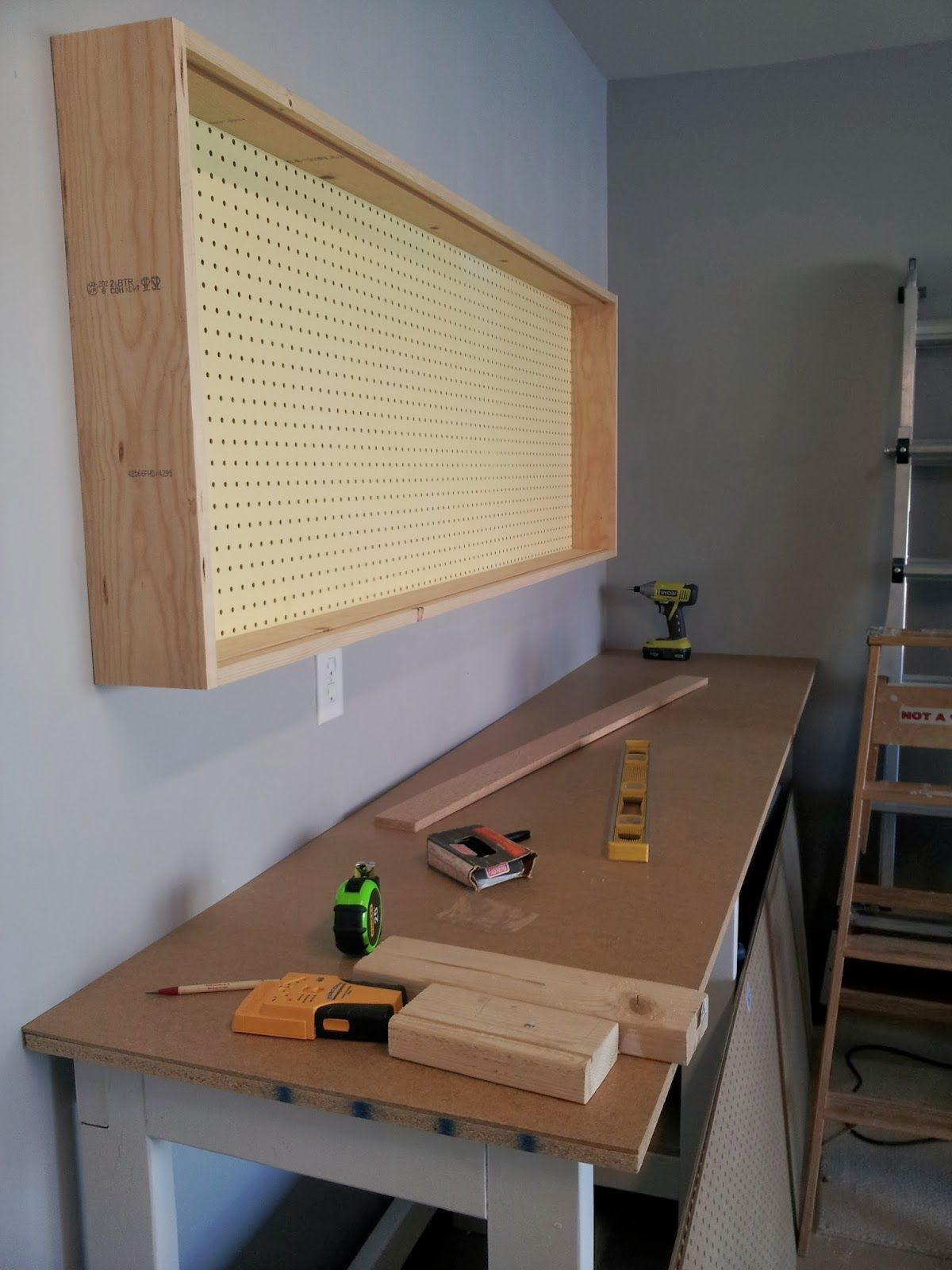 Base Of Pegboard Wall Mounted Tool Organizing Cabinet Featured On