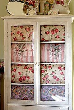 cabinet with vintage quilts and vintage decor - love it all!