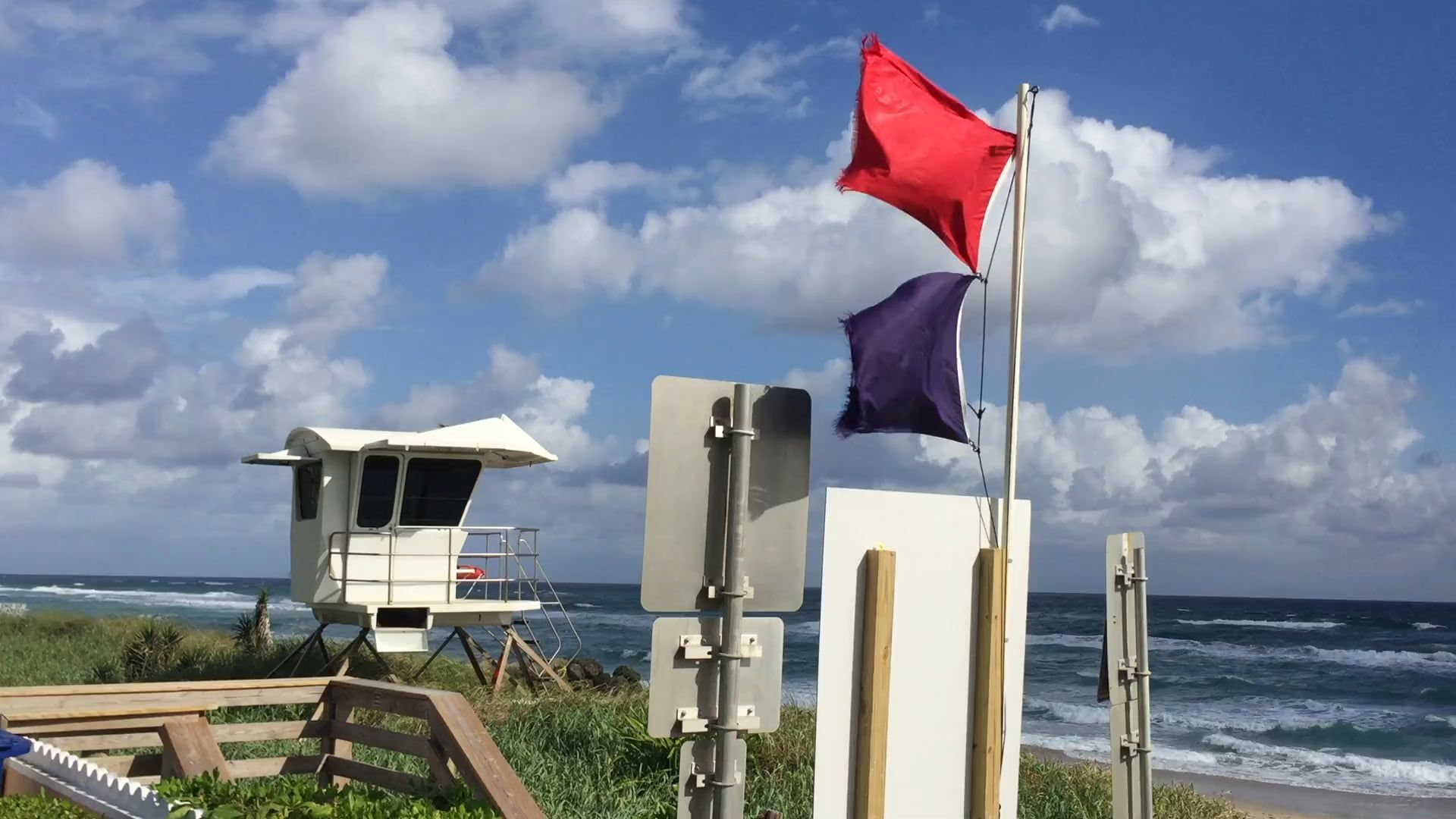 Rough Ocean With Red And Purple Flags Flying In The Town Of Palmbeach Ocean Palm Beach Towns
