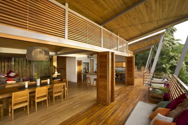 stelzenhaus modern pultdach-konstruktion offene wohnräume holz - holzverkleidung innen modern