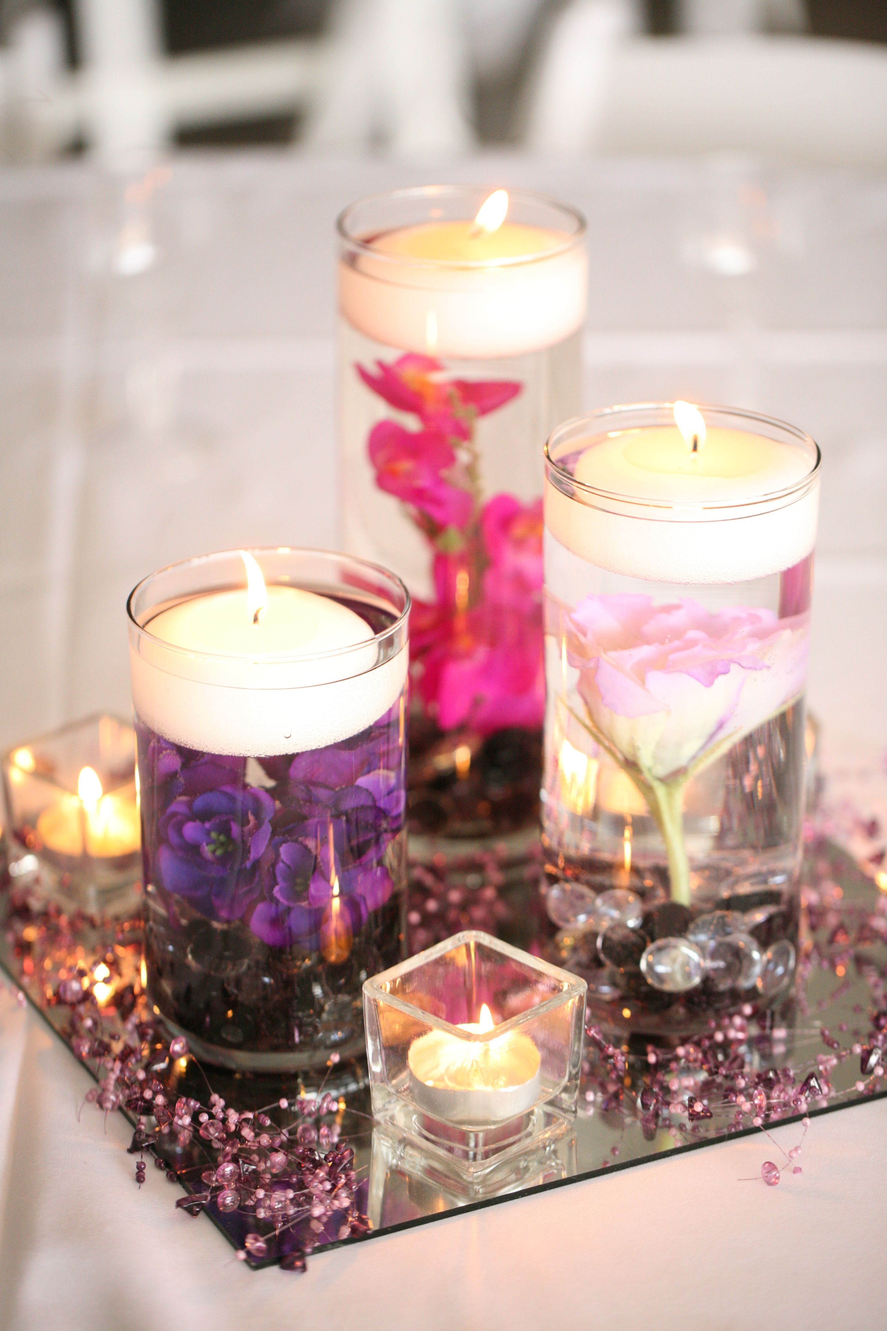 The centerpieces were silk flowers with glass gems in cylinder the centerpieces were silk flowers with glass gems in cylinder vases with a floating candle on reviewsmspy