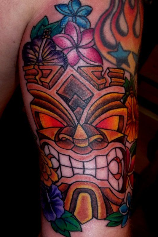 Hawaiian tiki n flowers tattoo designs http for Polynesian tiki tattoo
