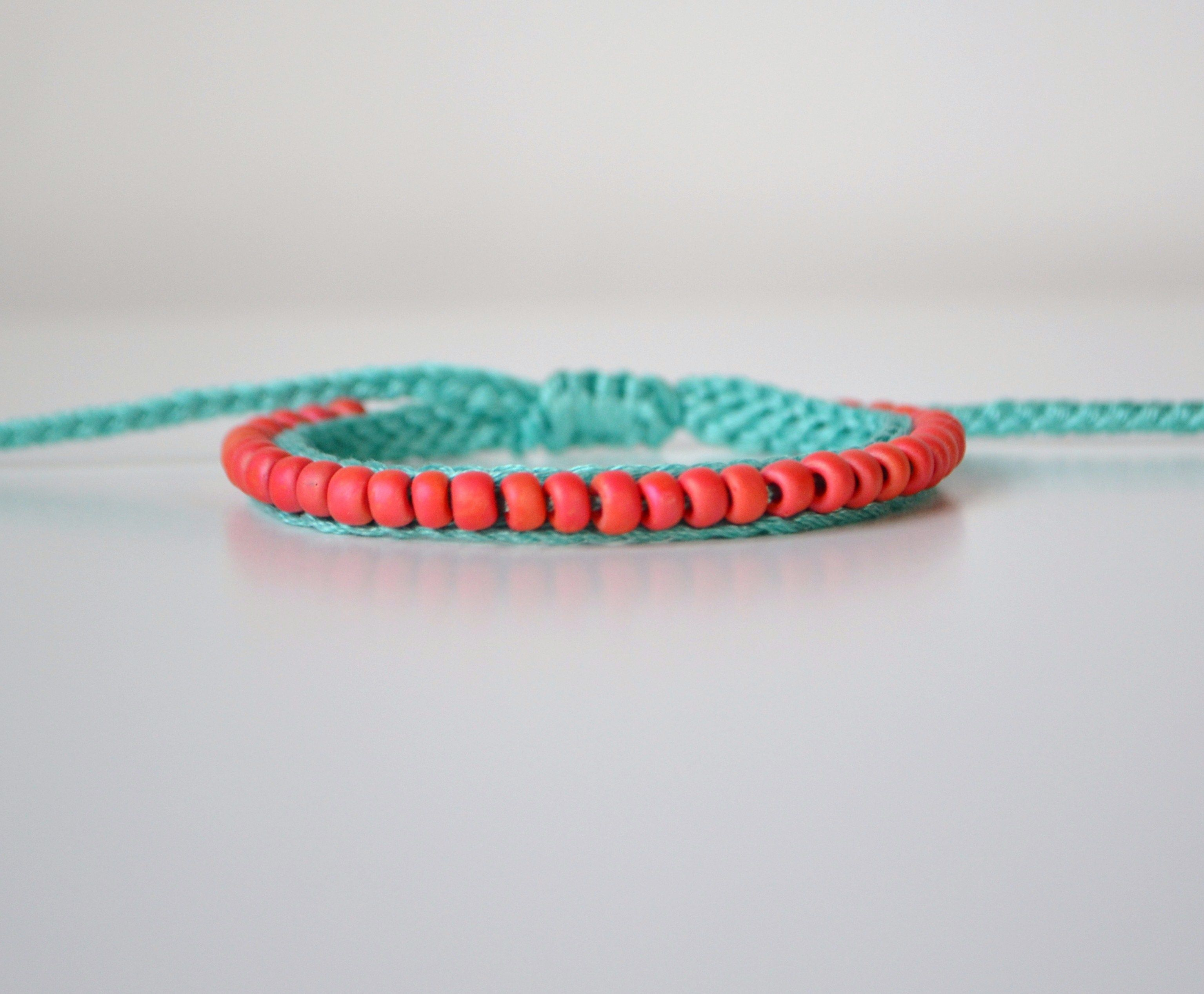 """This beaded friendship bracelet is hand crocheted with seagreen embroidery floss and coral beads. This bracelet has an adjustable knot making it """"one size fits all"""". It will fit most adult/teenage wrists, and it can be worn in a stack or alone for any occasion.    This bracelet is made to order, ..."""