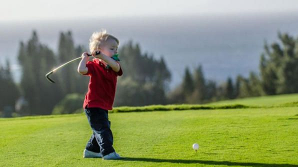 """Two years old and already has a great back swing. Arms straight, head down, eyes on the ball, pasy in the mouth. Playing Maui, HI. What more could you ask for?"" -- Ryan"