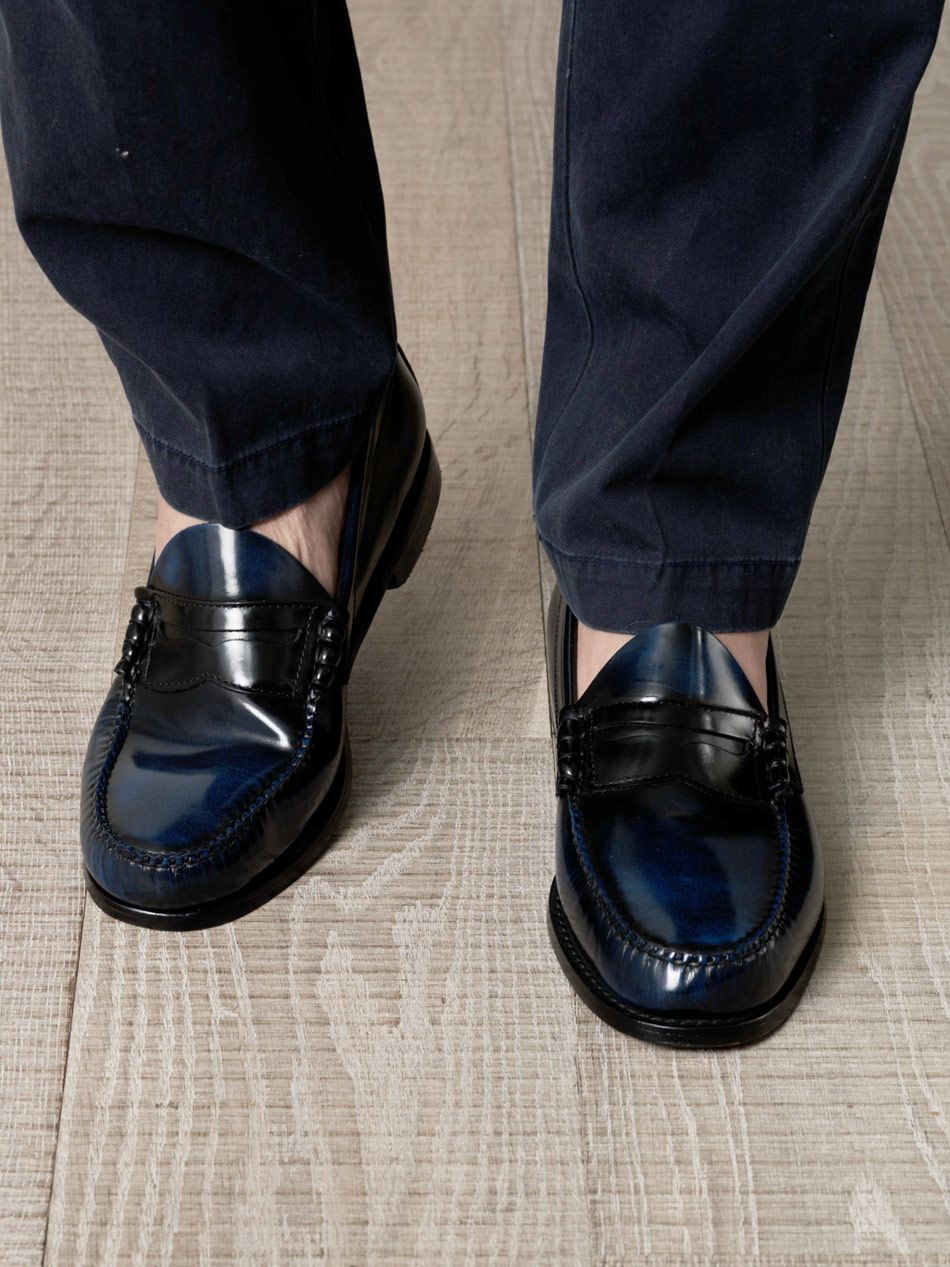 9397197a934 Round-toe Penny loafers cut from a blue and black burnished leather. Bass  Weejuns