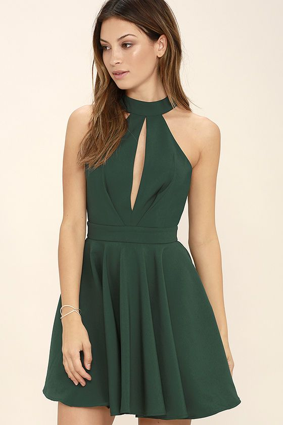 d07d496f01e You ll make a charming debut when you step out in the Smile Sweetly Forest  Green Skater Dress! A halter neckline (with buttoning back) tops a pleated  bodice ...