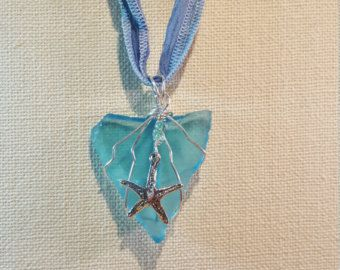 Genuine Sea Glass from beaches of Ocean County NJ. Rare aqua colored sea glass wrapped in sterling silver, accented with a sterling silver starfish charm and glass beads, strung on 36 inch hand dyed silk ribbon, which can be knotted at custom length. One of a kind stunning piece of jewelry.