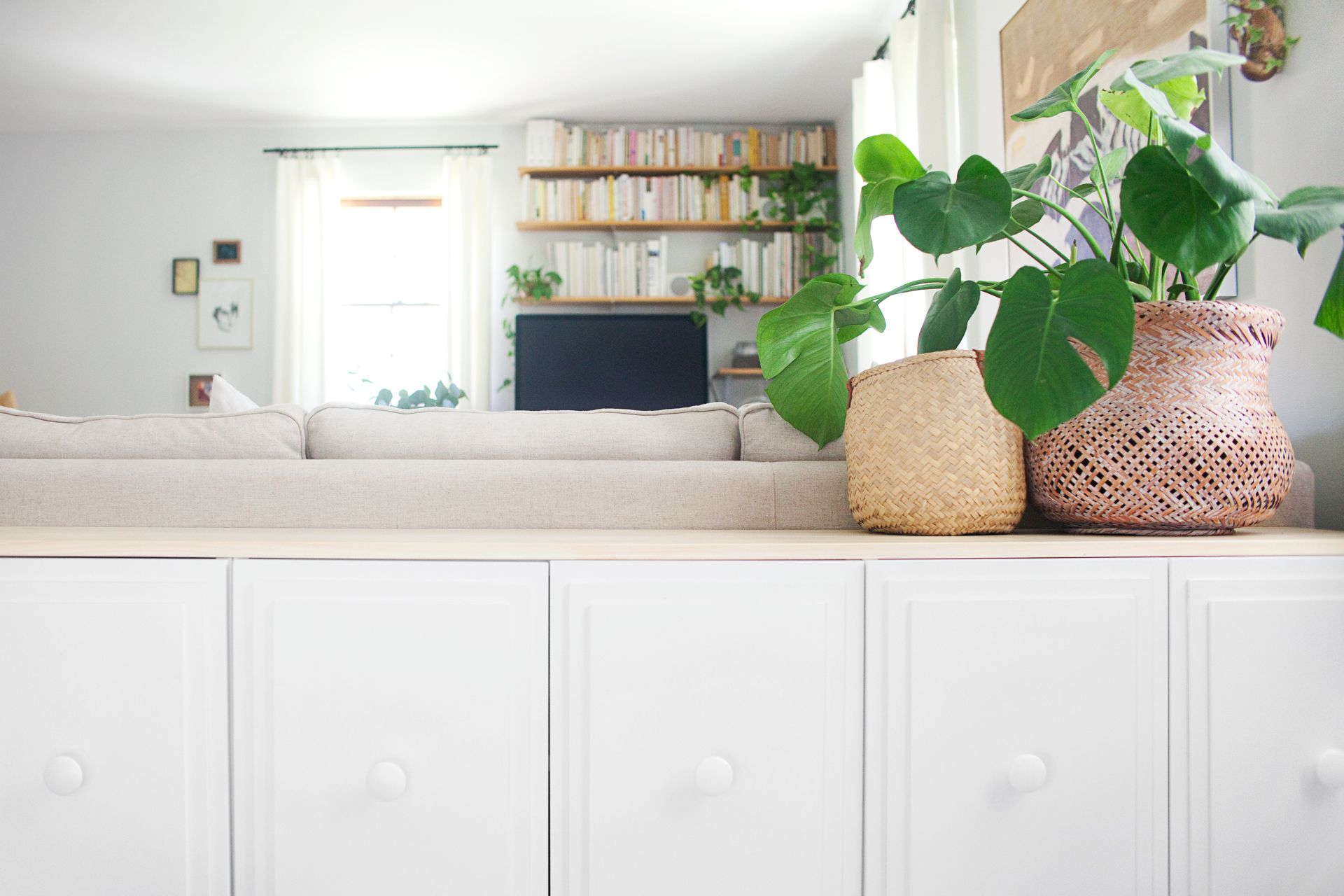 Storage chest behind couch as console table - stash B toys in living ...