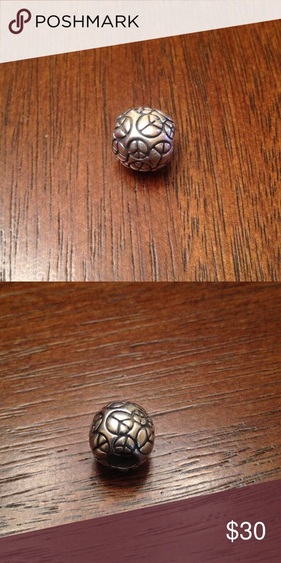 Pandora World Peace Charm This charm is discontinued on Pandora's site. It is in EUC!!! Pandora Jewelry Bracelets