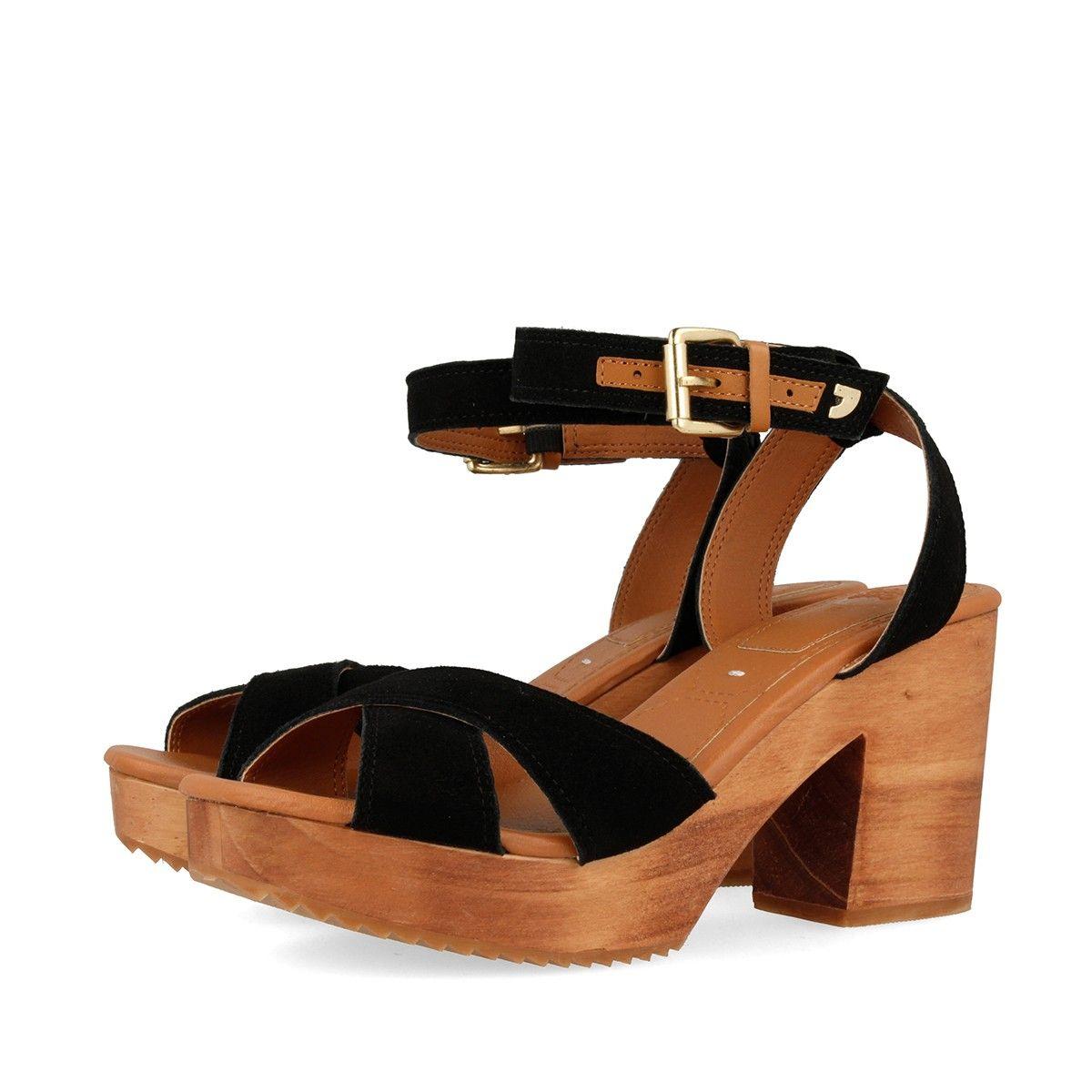 3f2daf47e2491 Sandalias negras de piel con plataforma y tacón de 9