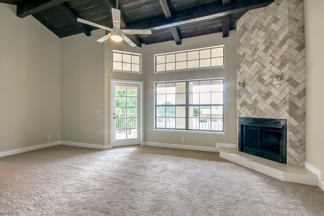 Floor to Ceiling Fireplace with herringbone patterned tile