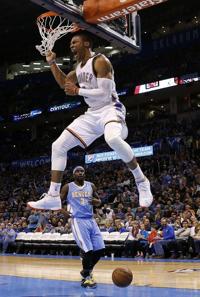 Oklahoma City s Russell Westbrook (0) celebrates a dunk in front of  Denver s Ty Lawson (3) during the NBA game between the Oklahoma City  Thunder and the ... f81ae85c3