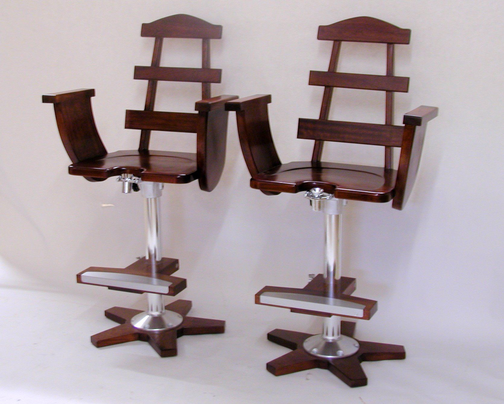 These are replicas of the Thomasville Hemingway Pilar Fighting Chairs I put 2 of the