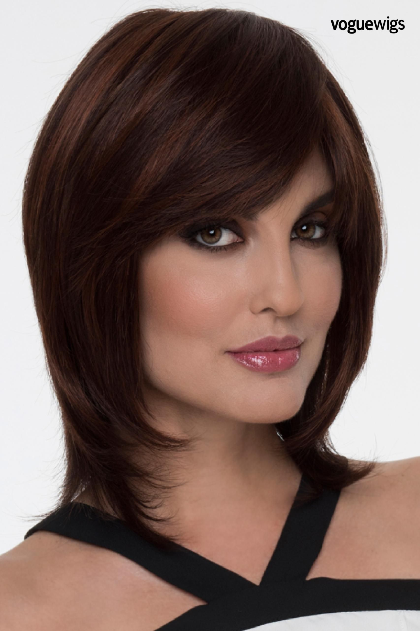 The Grace by Envy has a thick side swept bangs and long face