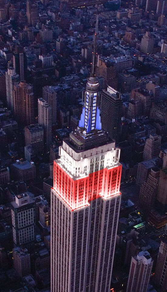 The lights of the Empire State Building shine in red, white and blue in honor of Memorial Day
