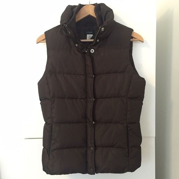 J.Crew Brown Puffer Vest Factory outlet down vest. Zips and snaps shut. Two on seam pockets for a sleeker look. This runs TTS/slightly small if you are familiar with their sizing. In good used condition. Interior elastic drawstring that can be tightened J. Crew Jackets & Coats Vests
