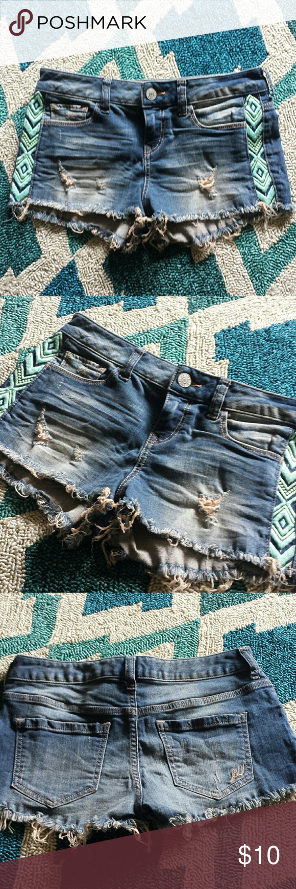Express Aztec Design Jean Shorts Cute blue Jean shorts size 2. Frayed look with pretty color Aztec look prints on it. Smoke free home. I ship fast and bundle. Express Shorts Jean Shorts