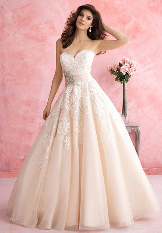 This ballgown is for the lover of all things feminine. It features a ...