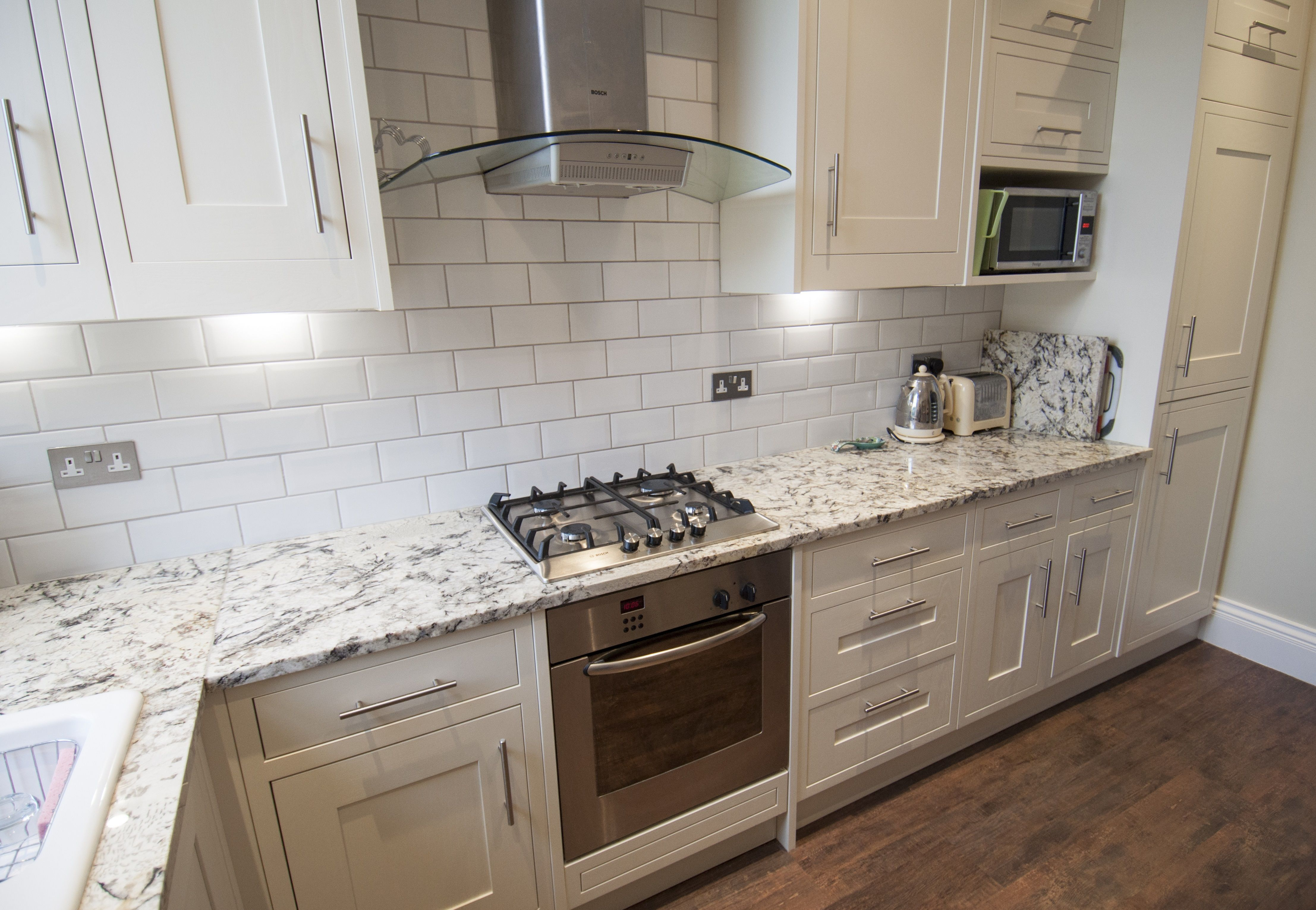 Antique Cream Granite Kitchen Worktops With White Cabinets And Tiles Installed In Blackheath London Granite Worktop Kitchen Kitchen Worktop Kitchen