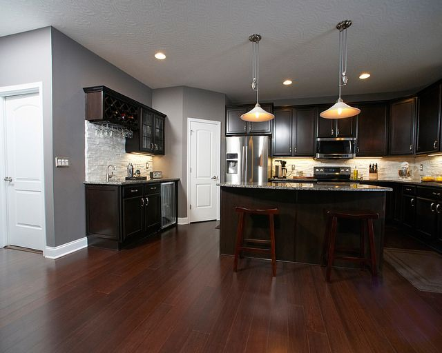 Pin By Wayne Homes On Wayne Homes Kitchens Dark Wood Kitchen Cabinets Cherry Cabinets Kitchen Grey Kitchen Walls