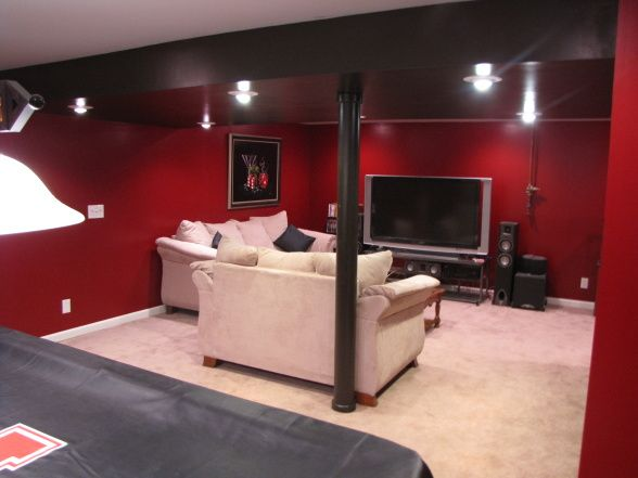 Red Basement But With Black Couches And White Ceiling Media Room Paint Colors Basement Remodeling Basement Decor