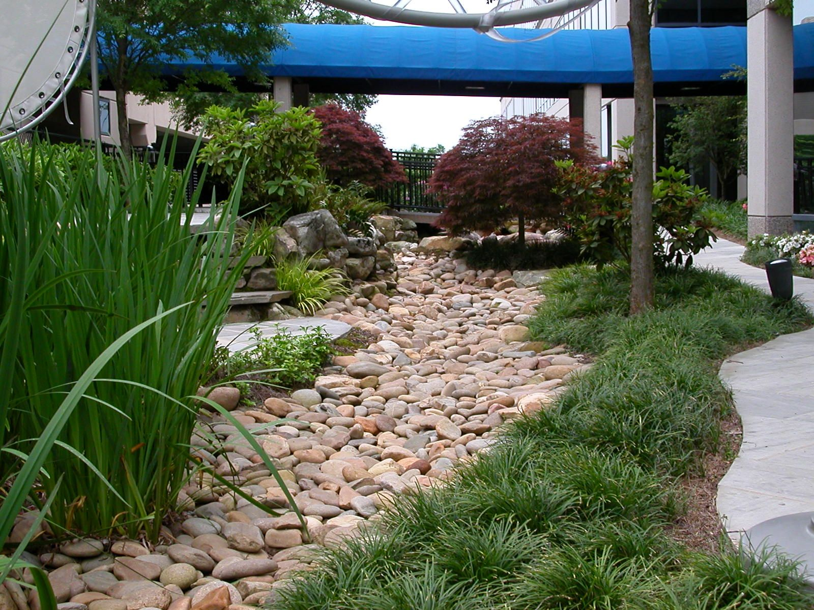 Backyard Drainage Ideas installing landscape drainage solutions dry_stream_beds copy Turning Your Drainage Ditch Into A Beautiful Dry Stream Bed Outdoor Landscaping Ideas Outdoor Landscaping