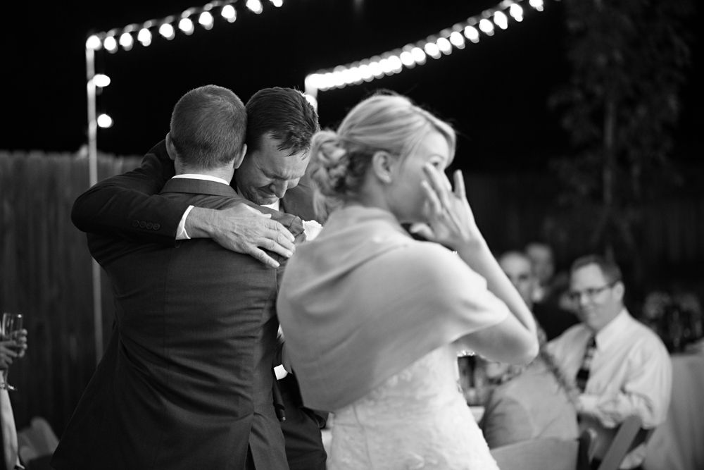 Father Giving A Speech At His Daughters Wedding And Hugging The Groom