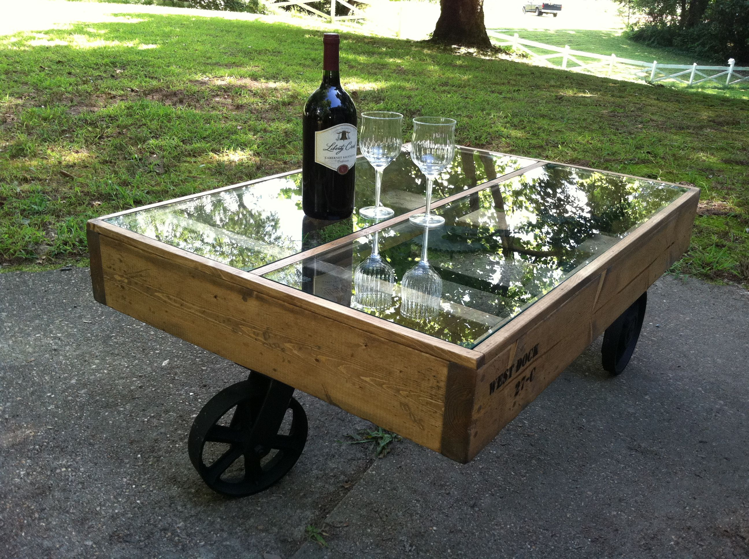 Another industrial cart coffee table with a glass top The two