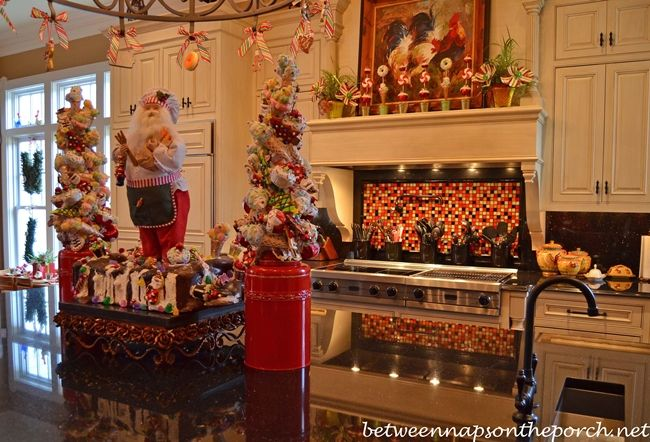 Tour a beautiful victorian home decorated for christmas for Christmas decorating kitchen cabinets