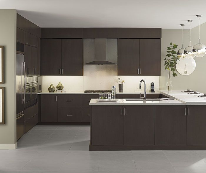 Sleek And Sublime Enjoy Every Day In This Clean Lined Space Featuring Desoto Wenge Kitch Kitchen Design Semi Custom Kitchen Cabinets Omega Cabinetry